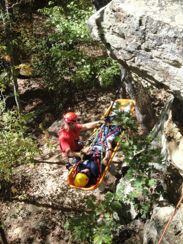 Firefighter participating in Advanced Wilderness Rope Rescue Course attends to patient. Photos by Russell McCullar