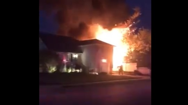 Flames from a Long Island, NY, house fire caused two propane tanks to explode Thursday.